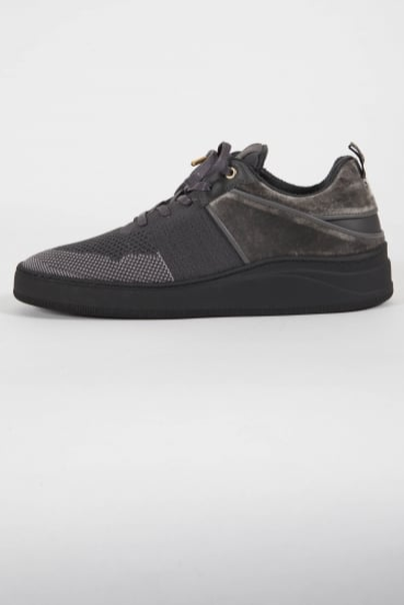 Grey sports trainer shoe with black knitted upper, rugged black Italian sole, and black velvet luxury panel detailing. Features include pull tag and flat waxed laces. Ultimate in luxury streetwear lowtops, and pictured in the middle of a plain white background.