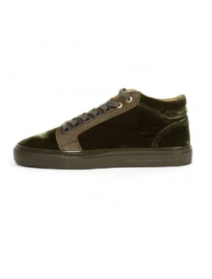 Green velvet mens trainers against a white background
