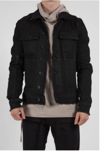 male model wearing a black denim jacket, with a nude t-shirt underneath
