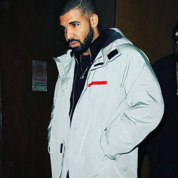 Drake wearing grey jacket