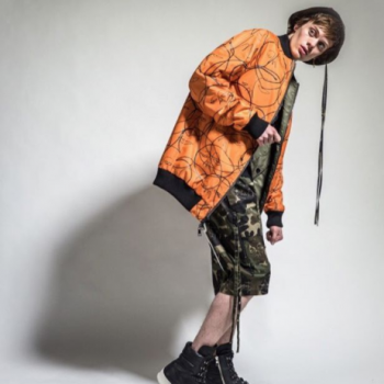 Model wearing orange Hacuulla jacket, cargo pants and trainers