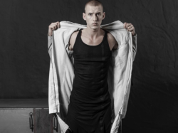 Model posing in Thom Krom jacket, vest and joggers