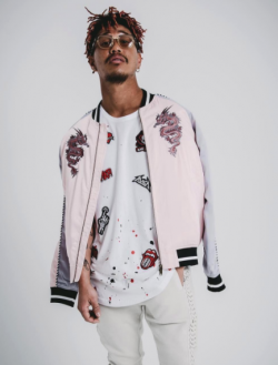 model wearing a pink silk Black Kaviar jacket
