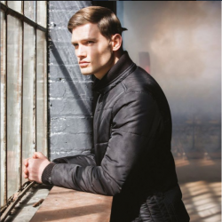 Remus Uomo model wearing black jacket, looking out of the window