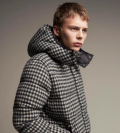 model wearing coat looking into the distance