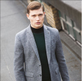 male model wearing turtleneck and grey blazer