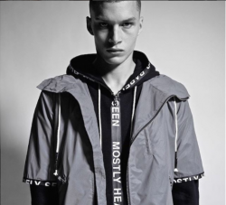 male model wearing a mostly heard but rarely seen designed coat, the image is in black and white